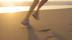Running woman feet close up exercise - stock footage