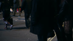 People cross streets at piccadilly circus in london at night. nightlife in lo Stock Footage