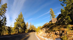 POV driving high Mountain Pass winter blue sky Sonora Pass Sierra Nevada, USA Stock Footage