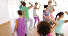 Zumba class dancing in studio Stock Footage