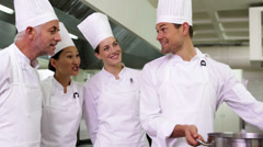 Stock Video Footage of Chef showing colleagues contents of large pot