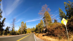 POV road driving Route 108 Sonora mountain Pass snow Wilderness Sierra Nevada Stock Footage