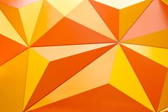 Abstract geometrical background with orange triangles Stock Photos