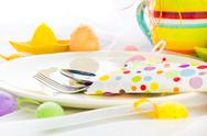 Stock Photo of cutlery wrapped napkin easter table