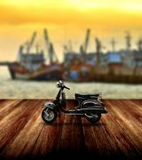 Stock Photo of black scooter parking beside jetty