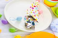 Stock Photo of easter table setting silverware wrapped napkin