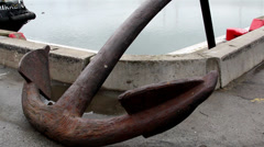 a big old anchor on the port area - stock footage