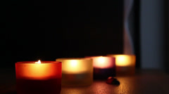 Four glass with candles Stock Footage
