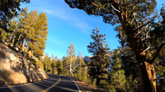 POV road trip vehicle driving winter snow Sonora Pass Wilderness Route 108 USA Stock Footage