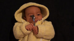 Three months old baby and a spoon Stock Footage