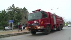 Fire Brigade rushes to scene of Suicide Bombing in Islamabad, Pakistan Stock Footage