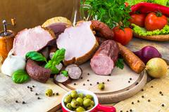 Variety processed meat products vegetables Stock Photos