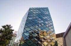 rhomboid-grid glass building - stock photo
