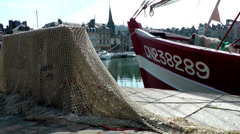 Europe France Normandy fishing village of Honfleur 013 fishing boat and nets Stock Footage