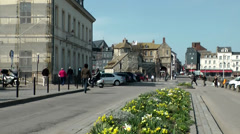 Europe France Normandy fishing village of Honfleur 002 flowers in the street Stock Footage