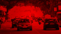 Traffic in city slow discolored to red background Stock Footage