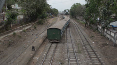 TRAIN - LOCOMOTIVE:: Overhead view green commuter train departs - stock footage