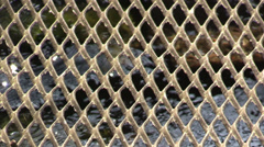 Steel grating and the current underneath water Stock Footage