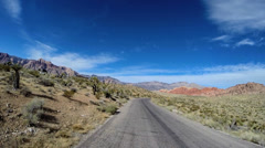 POV Red Rock road trip desert Route 159 blue sky extreme climate Nevada USA - stock footage