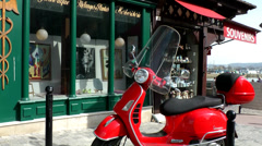 Europe France Normandy fishing village of Honfleur 017 red Italian scooter Stock Footage