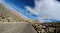 POV road trip desert driving extreme terrain Red Rock Mojave Desert Nevada USA - stock footage