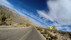 POV vehicle driving Red Rock Canyon State Park arid winter climate Nevada USA - stock footage