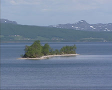 LAKE AURSUNDEN, NORWAY: Small island in lake glacial landscape Stock Footage