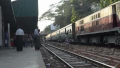 TRAIN - LOCOMOTIVE: Wide shot of sunny train arriving on far platform - stock footage