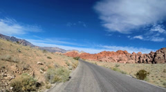 POV vehicle driving Red Rock Canyon State Park Keystone Thurst Nevada USA - stock footage