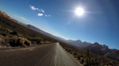 POV road trip Red Rock Canyon vehicle blue winter climate Mojave Desert Nevada - stock footage