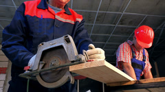 Group people builder with circular saw. Stock Footage