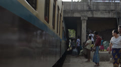 TRAIN - LOCOMOTIVE: Very close to side of train with passengers boarding - stock footage
