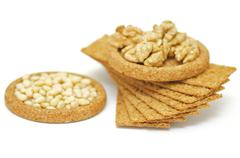 wholegrains crispbread with peanut and pine nut isolated on white background - stock photo