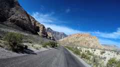 POV road trip desert driving State Route 159 extreme terrain Red Rock Nevada USA - stock footage