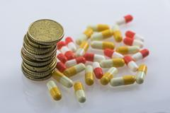 Concept of sanitary copayment, money and medicines Stock Photos