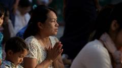 Woman Praying at a Buddhist Pagoda Stock Footage