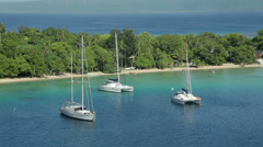 yachts moored in tropical island. Port vila harbour, vanuatu - stock footage