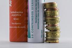 effervescent tablets tubes together to euro coins, concept of copayment pharm - stock photo