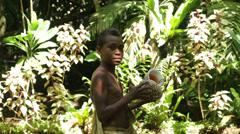 futuna boy with horn, ekasup village, port vila, vanuatu - stock footage