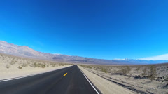 POV road trip Death Valley hot climate blue sky dry California USA sun flare Stock Footage