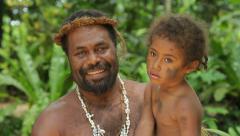 Portrait of ethnic man and boy at ekasup village, port vila, vanuatu Stock Footage