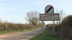 End of village of halse road sign and country road in nothamptonsh Stock Footage