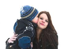 a big hug and a kiss for mommy - stock photo