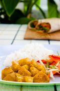 curried chicken with rice and vegetables - jamaican style - stock photo