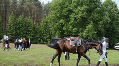 People riders prepare horses for steeplechase barrier race Stock Footage