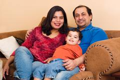 east indian couple with their son - stock photo