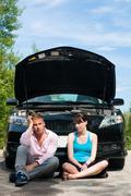 road trip - car broke down - stock photo