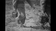 Military photographers walking with camera Stock Footage