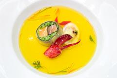 seafood broth with lobster claw - stock photo