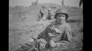 Military photographer with camera resting Stock Footage